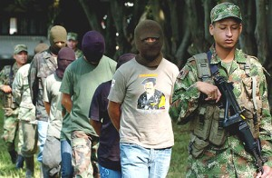 <i>FARC members captured by Colombian army</i>&#8221; title=&#8221;1241565569_0&#8243; width=&#8221;300&#8243; height=&#8221;196&#8243; class=&#8221;size-medium wp-image-12178&#8243; /></a><figcaption class=